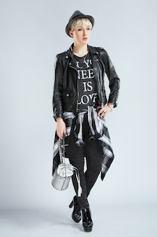 Stylist in fashionable outfit, full body. person in sphere of fashion in black casual clothes, trendy blonde woman. shopping, indoors