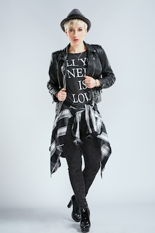 Stylist in fashionable outfit looking at camera, full body. person in sphere of fashion in black casual clothes, trendy blonde woman in black. shopping, indoors