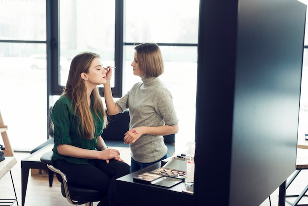 Stylist working with model in studio
