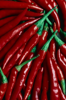Stylized background of fresh red chili peppers
