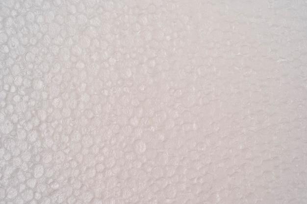 発泡スチロールのテクスチャ背景プラスチックフォームのテクスチャ白い発泡スチロール板ポリスチレンシートの表面