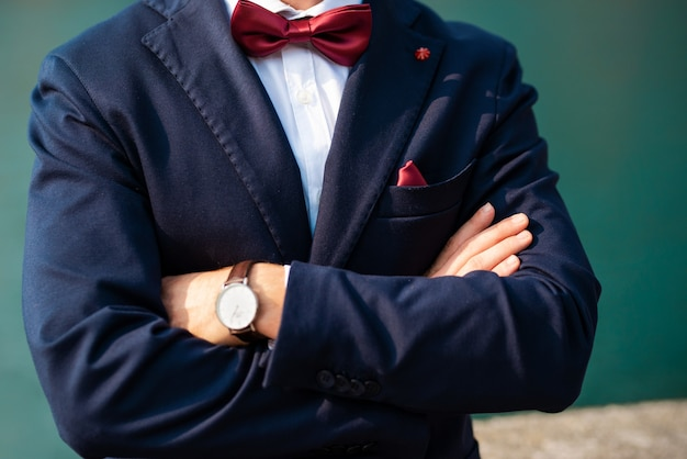 Suave modern man in casual style with the watch on hand.