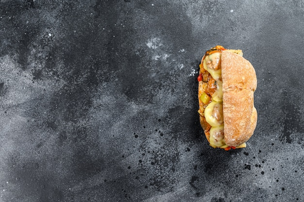 Submarine sandwich with meatballs, ricotta cheese. top view. copy space