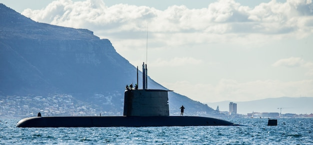 Submarine in the above-water position in the bay