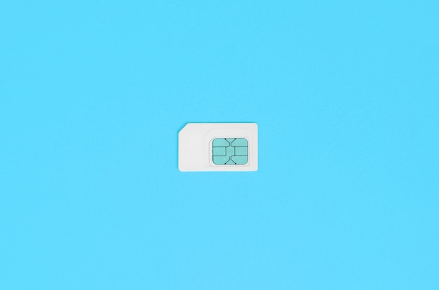 Subscriber identity module. white sim card on blue