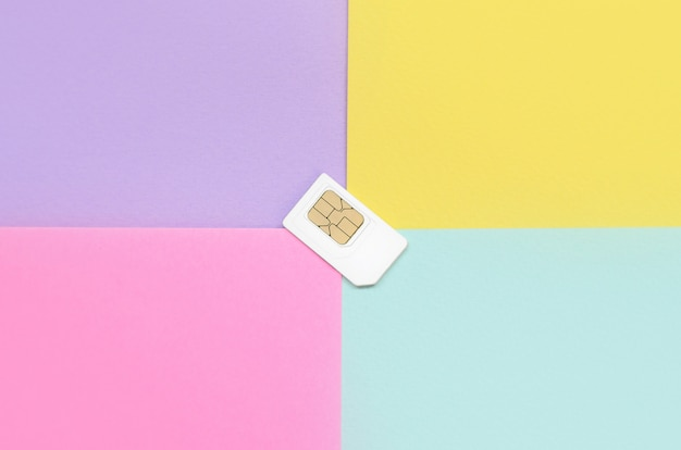 Subscriber identity module. white sim card on pastel background