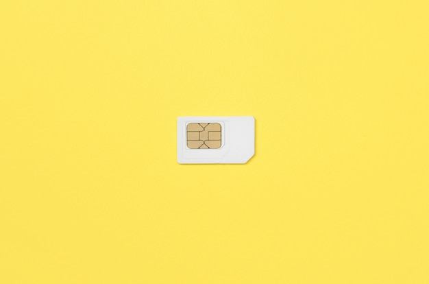 Subscriber identity module. white sim card on yellow background