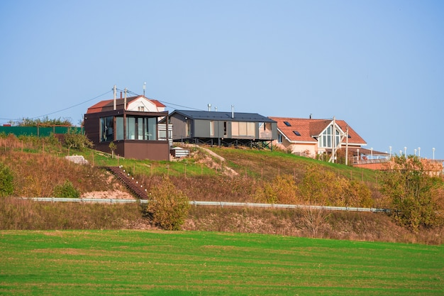 Suburban luxury real estate, modern cottage on a green hill. russia.