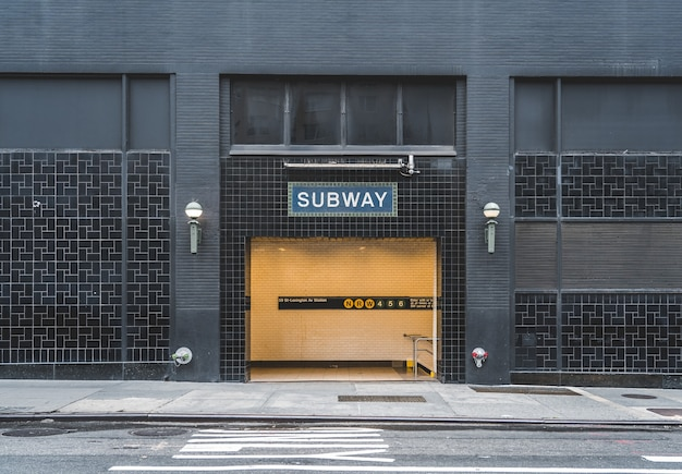 Subway sign on a metro entrance in new york