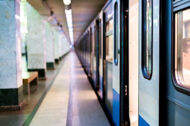 Subway train staying on a metro station with doors open