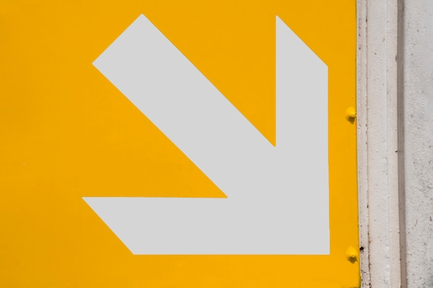Subway white arrow on yellow background