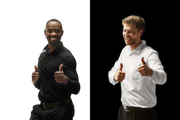 The success happy afro and caucasian men
