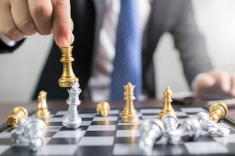 Success, management and business leadership concept, businessman moving king chess to win