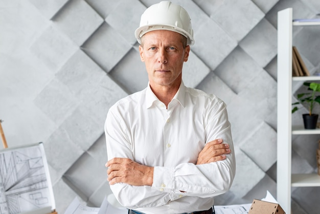 Successful architect with safety helmet