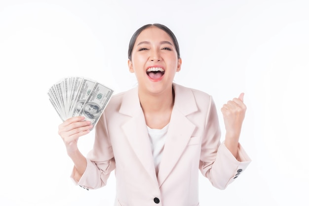 Successful beautiful asian business young woman holding money us dollar bills in hand ,excited  business woman concept