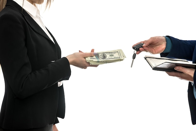 Successful business deal between partners  for auto sales isolated on white wall. dollar. financial concept.
