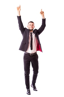 腕を開いて成功したビジネスマン-白い壁に隔離