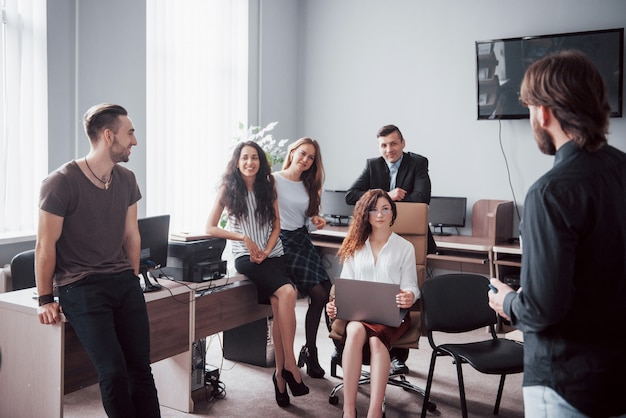 Successful business people are talking and smiling during in office.