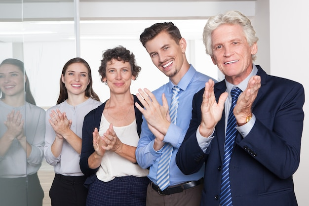 Successful business people smiling and applauding