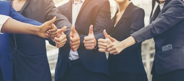 Successful of business teamwork showing thumbs up sign. business concept.