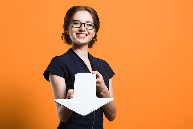 Successful business woman showing paper pointer in her hands