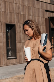 A successful, business woman. the style of a business woman. in the hands of a magazine and coffee.