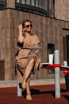 A successful, business woman. the style of a business woman.