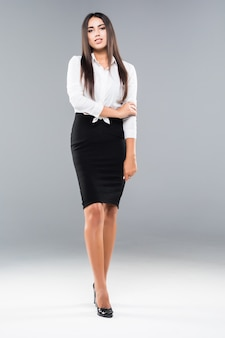 Successful business woman with arms crossed on white. beautiful business woman. full length image of young businesswoman.