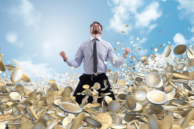 Successful businessman exults over a lot of money coins