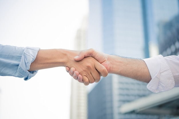 Successful businessman handshaking after good deal.
