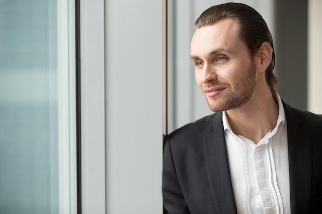 Successful businessman imagines great career