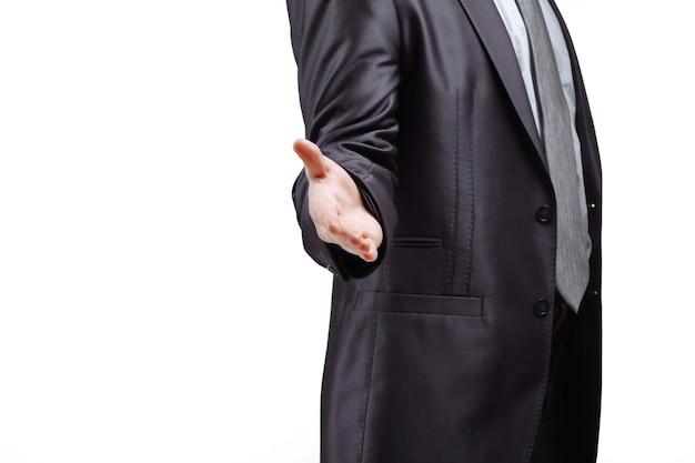 성공적인 사업가는 회색 배경에 handshake.isolated를 위해 손을 뻗습니다.