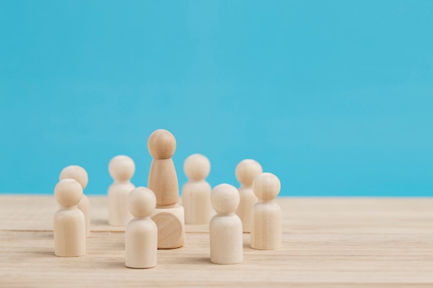Successful businessman standing out from the crowd