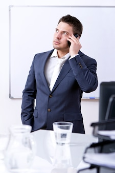 Successful businessman using cellphone