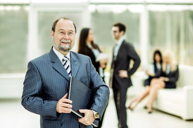 Successful businessman with documents on the wall of business team and office.