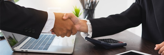 Successful contract negotiate and handshake concept, two businessman shake hand with partner to celebration partnership.