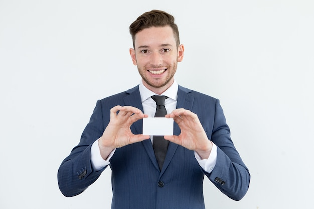 Successful financial advisor showing blank card