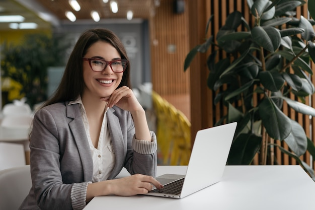 Successful financial advisor sitting at workplace