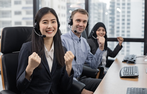 Successful of group of diverse telemarketing customer service staff team in call center. call center worker accompanied by team. smiling of customer support operator at work.