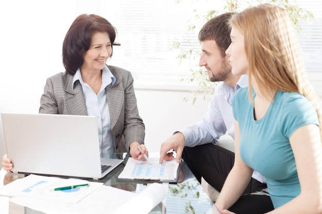 Successful lawyer giving consultation to family couple