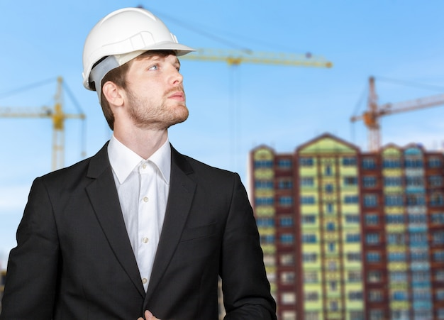 Successful male architect at a building site