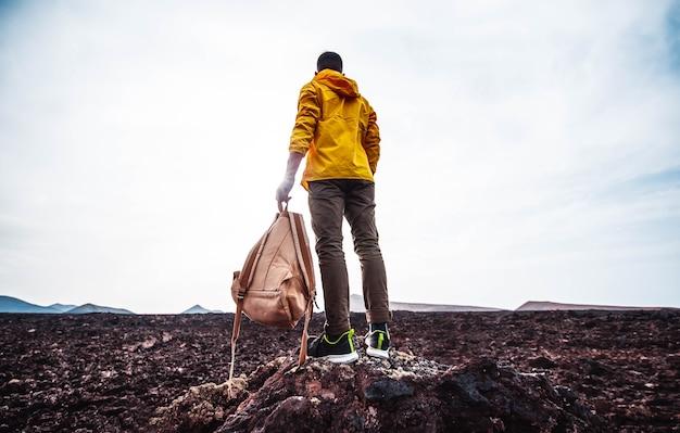 Successful man hiking mountains