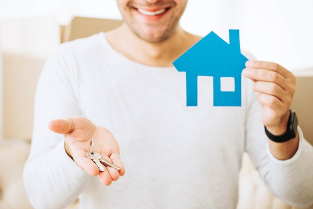 Successful man with keys from new house