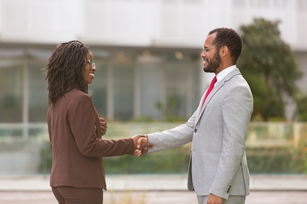 Successful multiethnic businesspeople greeting each other