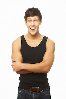 Successful muscled young man smiling