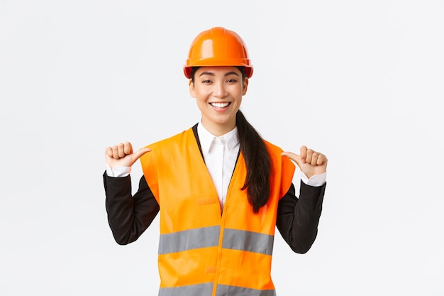 Successful proud smiling asian female construction manager