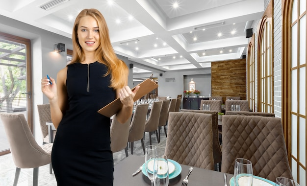 Successful restaurant manager with folder