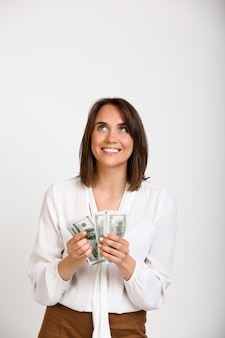 Successful rich fashion woman counting money