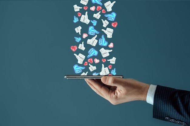 Successful social media advertising strategy. a lot of likes fall on the smartphone. the concept of creative marketing, popularity, many subscribers.
