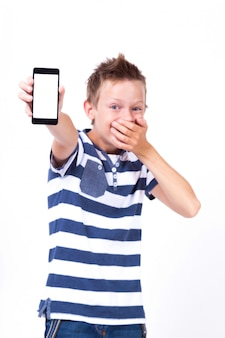 Successful student with a phone in his hand on white